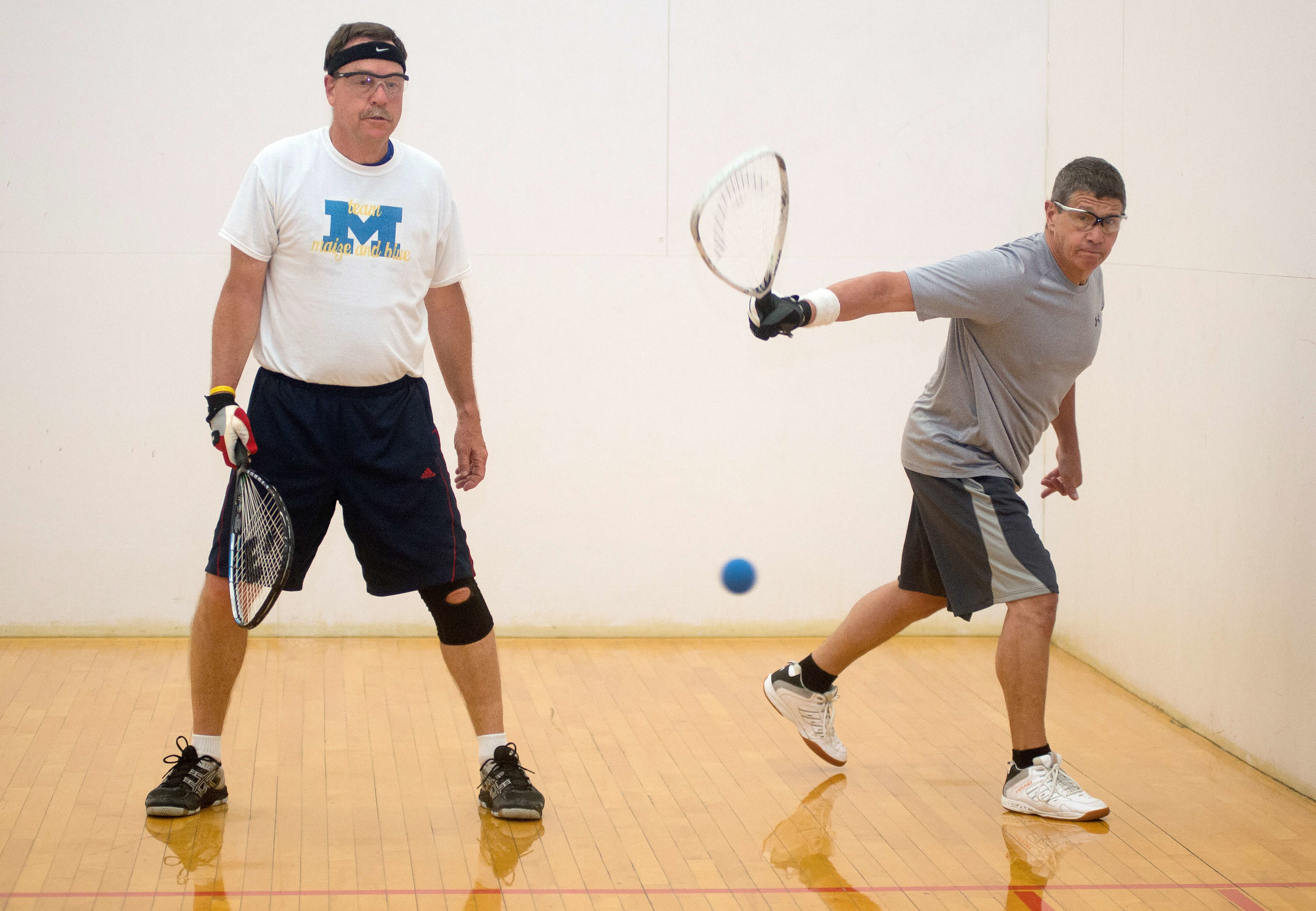 two men playing racquetball